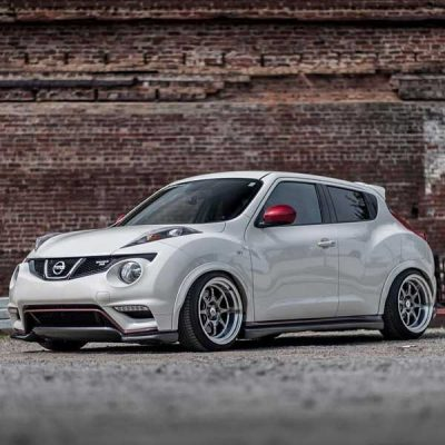 2014 Nismo Nisan Juke with Hyper Black CP25 Wheels in front of brick wall