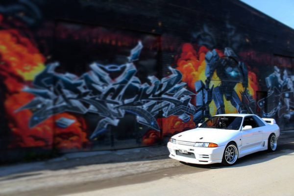 Nissan Skyline GTR R32 featuring 18x10.5 CP25 Wheels Hyper Black Finish with 265/35-18 Achilles Tires in front of mural